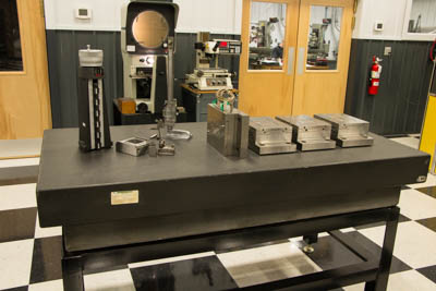 Eden Tool Inspection area with surface plate, gages, comparator, microscope.